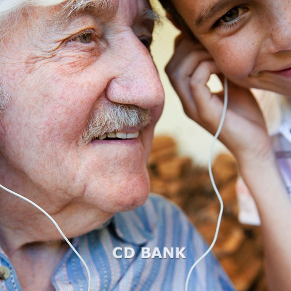 42-17649764 grandfather and grandson with ear buds