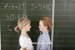 Children in front of blackboard in class Stock Photo
